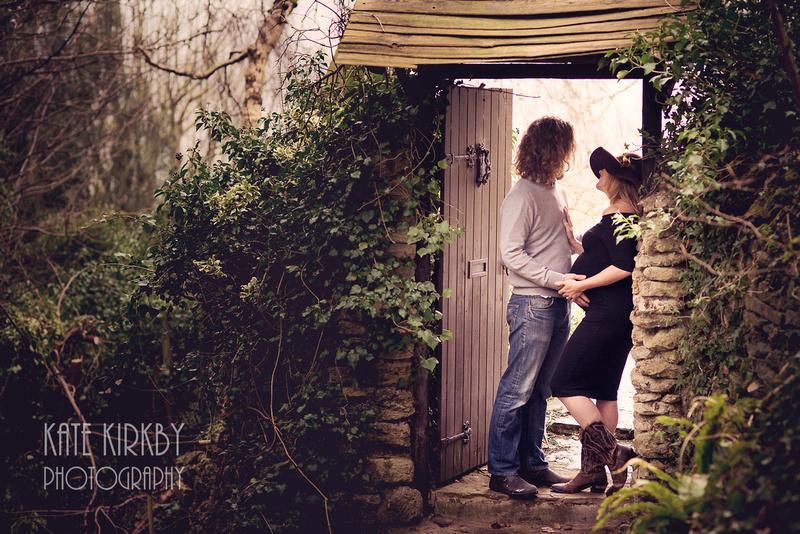 Expecting couple in doorway